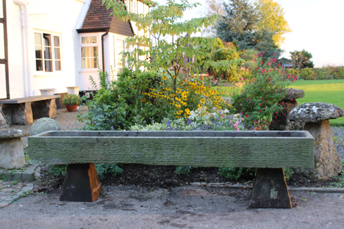Long planting stone trough