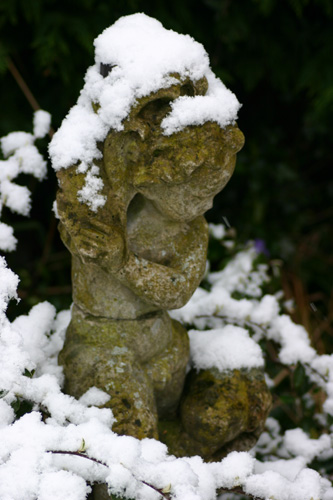 Stone Statue with snow